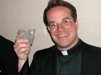 priest drinking