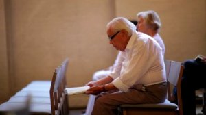 stock-footage-denmark-july-elderly-man-in-church-in-copenhagen-denmark