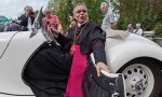 Bishop Franz-Peter Tebartz-van Elst in a vintage BMW.