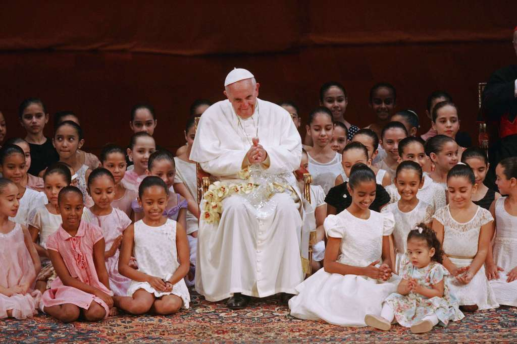 Pope Francis meets with children during an encounter with representatives of the civil society in the Municipal Theater in Rio de Janeiro